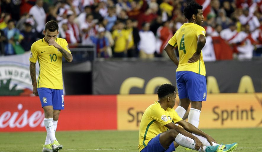 Brazil's Lucas Lima (10) and Gil (4) stand on the pitch after a 1-0 loss to Peru in a Copa America Group B soccer match on Sunday, June 12, 2016, in Foxborough, Mass. (AP Photo/Elise Amendola)