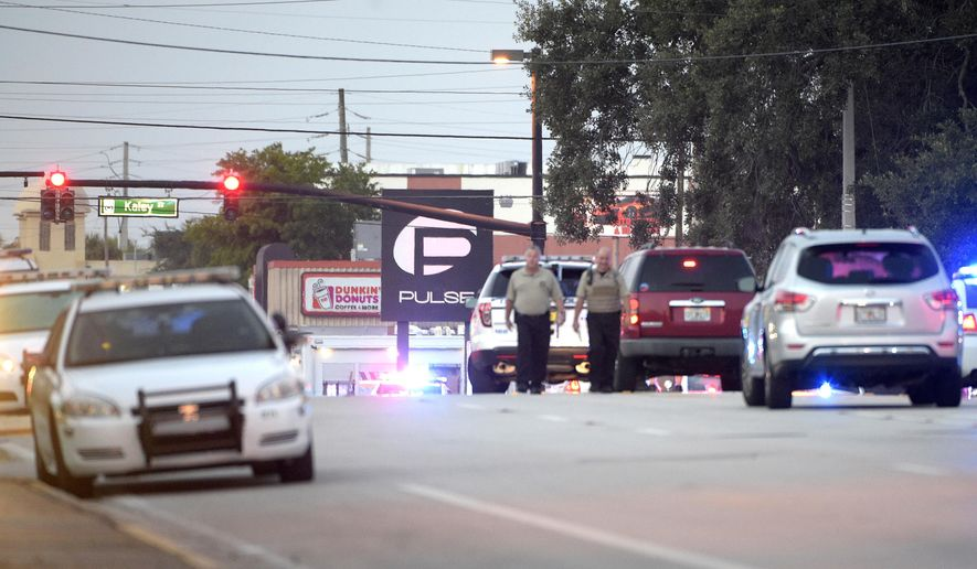 Police cars surround the Pulse Orlando nightclub, the scene of a fatal shooting, in Orlando, Fla., Sunday, June 12, 2016. (AP Photo/Phelan M. Ebenhack) ** FILE **