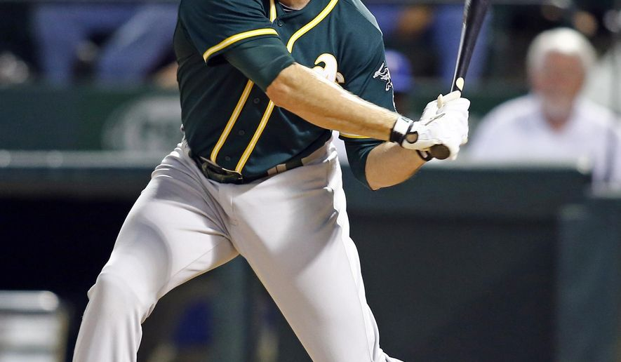 In this Saturday, May 2, 2015 photo, Oakland Athletics' Ike Davis bats against the Texas Rangers in a baseball game in Arlington, Texas. The New York Yankees are trying to close a deal for free agent first baseman Davis, hoping to add depth at a position where they've been hurt this season. (AP Photo/Mike Stone)