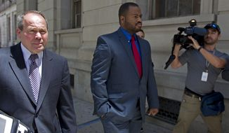 Officer William Porter, right, one of six Baltimore city police officers charged in connection to the death of Freddie Gray, accompanied by his Attorney Joseph Murtha leaves the courthouse, after testifying in the trial of Officer Caesar Goodson, one of six Baltimore city police officers charged in connection to the death of Freddie Gray, Monday, June 13, 2016, in Baltimore. Porter's trial in the Gray case ended in mistrial. He will be tried again in September. (AP Photo/Jose Luis Magana)