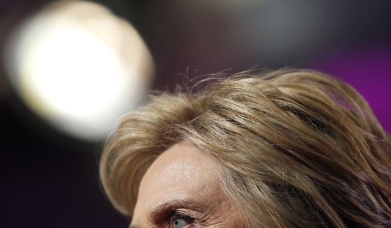 """File-This June 10, 2016, file photo shows Democratic presidential candidate Hillary Clinton pausing while speaking during a Planned Parenthood Action Fund membership event, in Washington. Republican Donald Trump plans Monday, June 13, 2016, to further address the deadliest shooting in modern U.S. history in a campaign speech originally intended to attack the presumptive Democratic nominee, Hillary Clinton. The switch comes a day after Trump called for Clinton to drop out of the race for president if she didn't use the words """"radical Islam"""" to describe the Florida nightclub massacre. (AP Photo/Alex Brandon, File)"""