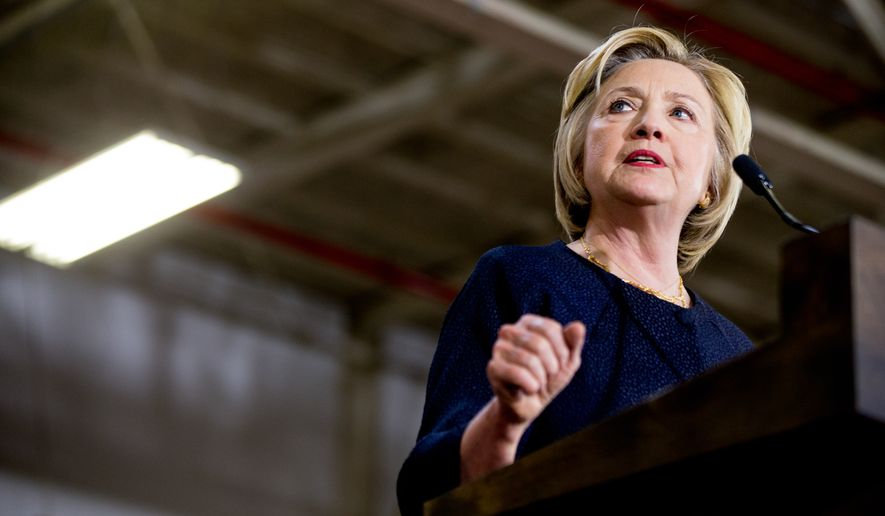 """Democratic presidential candidate Hillary Clinton speaks at a rally at a warehouse for the company """"Team Wendy"""" which produces helmets for military, law enforcement, and rescue teams, in Cleveland, Monday, June 13, 2016. (AP Photo/Andrew Harnik)"""