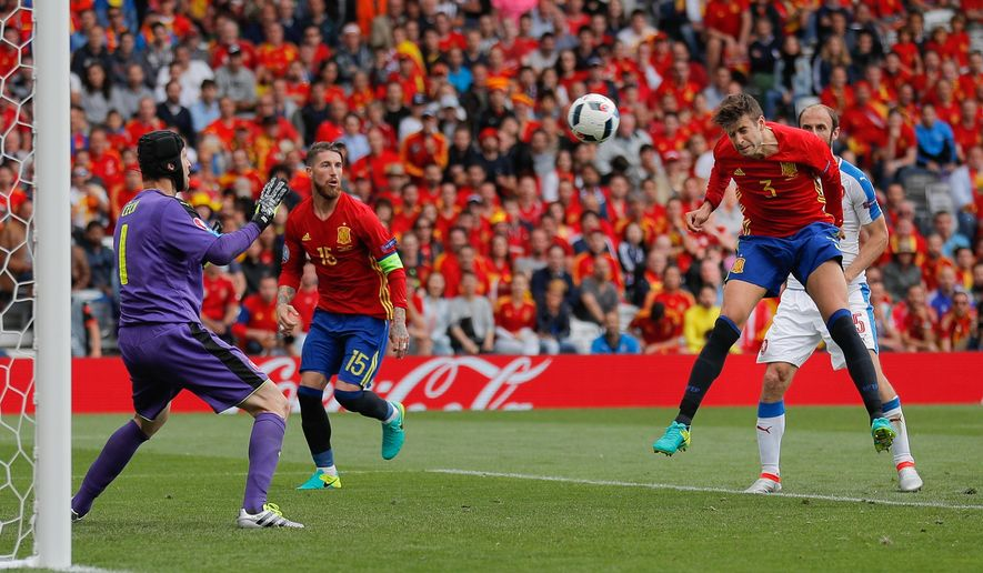 Spain's Gerard Pique scores the opening goal during the Euro 2016 Group D soccer match between Spain and the Czech Republic at the Stadium municipal in Toulouse, France, Monday, June 13, 2016. (AP Photo/Manu Fernandez)