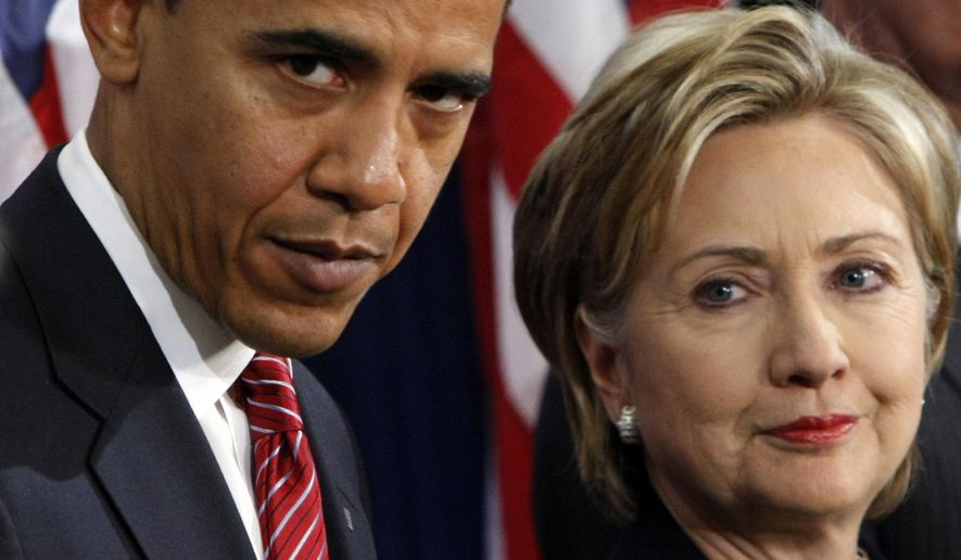 In this Dec. 1, 2008, photo, then-President-elect Barack Obama (left) stands with then-Sen. Hillary Rodham Clinton, D-N.Y., after announcing that she is his choice as secretary of state during a news conference in Chicago. (Associated Press) **FILE**