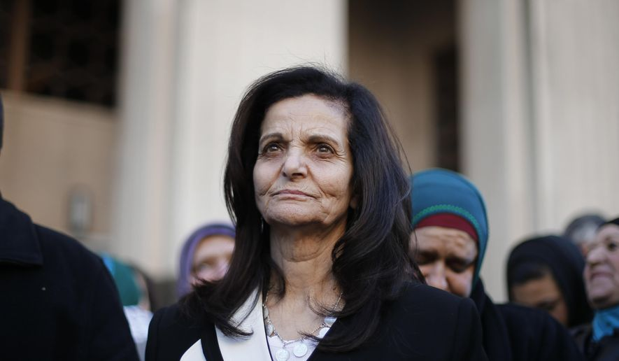 Rasmea Odeh listens to supporters after leaving federal court in Detroit, in this March 12, 2015, file photo. (AP Photo/Paul Sancya, File) **FILE**