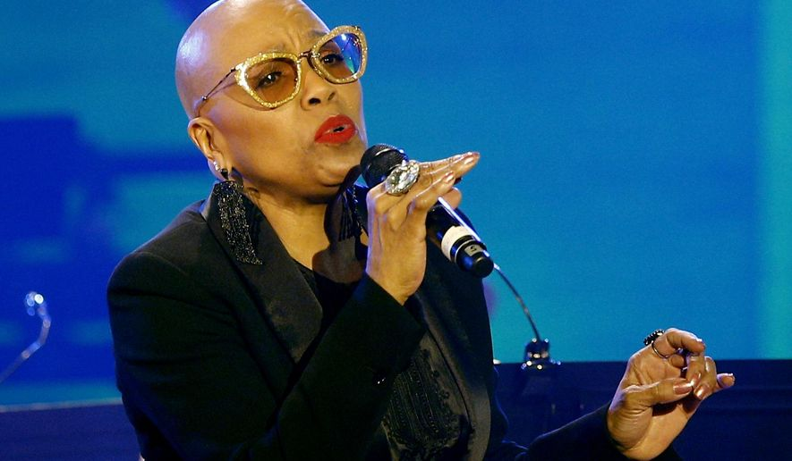 In this Thursday, April 30, 2015 photo, U.S. jazz singer Dee Dee Bridgewater performs at the U.N.'s culture agency UNESCO in Paris, France. The National Endowment for the Arts announced Monday, June 13, 2016, during a DC JazzFest concert at the Kennedy Center in Washington that Bridgewater was among five 2017 NEA Jazz Masters. (AP Photo/Christophe Ena)
