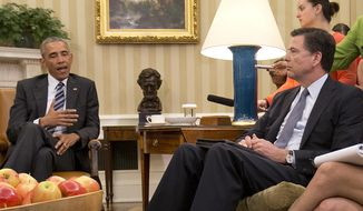 """FBI Director James Comey, right, listens to President Barack Obama, left, speak to members of the media in the Oval Office of the White House in Washington, Monday, June 13, 2016, after meeting with the FBI Director and others.  Comey says the gunman in the Orlando nightclub attack that killed 49 people had """"strong indications of radicalization"""" and was likely inspired by foreign terrorist organizations.  (AP Photo/Pablo Martinez Monsivais)"""