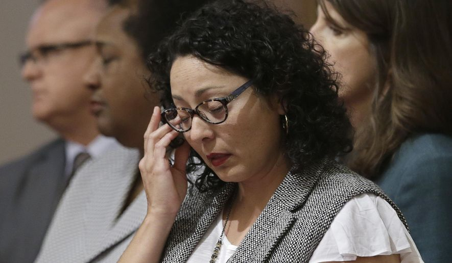 Assemblywoman Cristina Garcia, D-Bell Gardens, wipes her eyes as she listens to members of the women's caucus in the state Senate read a letter from the victim in the Stanford sexual assault case Monday, June 13, 2016, at the Capitol in Sacramento, Calif. Garcia, and Assemblywoman Susan Eggman, D-Stockton, have proposed legislation to expand the definition of rape, now described as an act of sexual intercourse, to include the forcible acts of sexual penetration with any body part or foreign object. (AP Photo/Rich Pedroncelli)