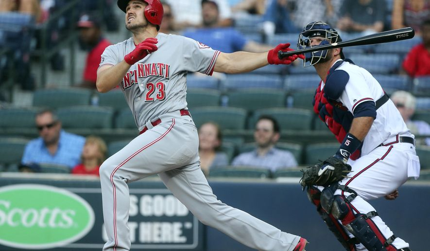 Cincinnati Reds' Adam Duvall (23) follows through on a two-run home run as Atlanta Braves catcher A.J. Pierzynski watches during the first inning of a baseball game Monday, June 13, 2016, in Atlanta. (AP Photo/John Bazemore)