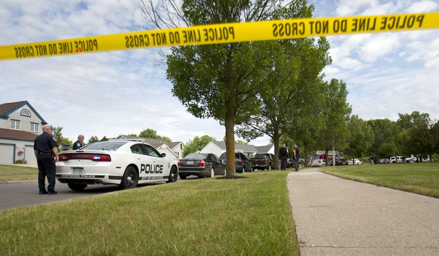 Authorities respond to the scene near where police shot and killed an armed bank robbery suspect on Eastcastle Drive SE, at Oxford Place Apartments in Grand Rapids Monday, June 13, 2016. The suspect allegedly robbed ATL Credit Union, in Wyoming, Mich. (Cory Morse/The Grand Rapids Press-MLive.comvia AP)