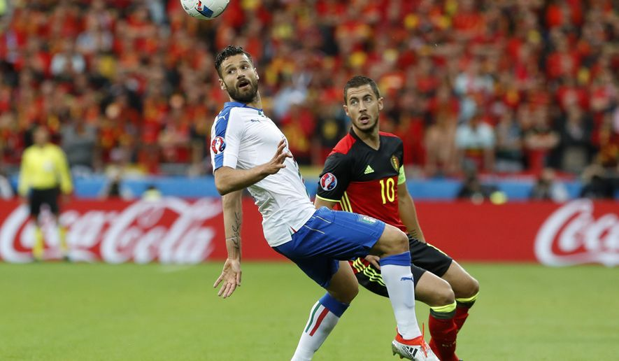 Italy's Antonio Candreva, left, and Belgium's Eden Hazard go for the ball during the Euro 2016 Group E soccer match between Belgium and Italy at the Grand Stade in Decines-Charpieu, near Lyon, France, Monday, June 13, 2016. (AP Photo/Laurent Cipriani)
