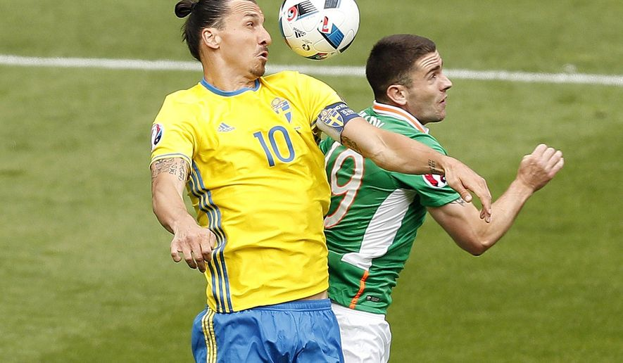 Sweden's Zlatan Ibrahimovic, left, and Republic of Ireland's Robbie Brady battle for the ball during the Euro 2016 Group E soccer match between Ireland and Sweden at the Stade de France in Saint-Denis, north of Paris, France, Monday, June 13, 2016. (AP Photo/Francois Mori)