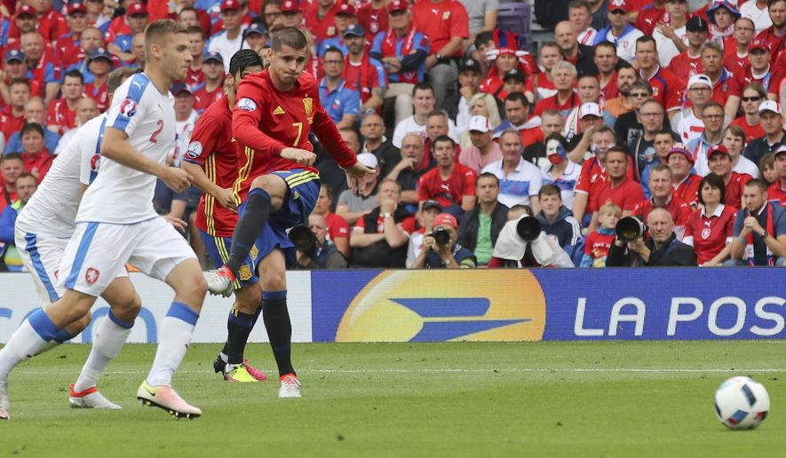 Spain's Alvaro Morata, right, fires a shot  during the Euro 2016 Group D soccer match between Spain and the Czech Republic at the Stadium municipal in Toulouse, France, Monday, June 13, 2016. (AP Photo/Andrew Medichini)