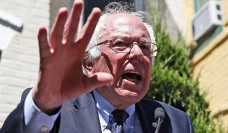 Sen. Bernie Sanders, Vermont independent and Democratic presidential candidate, speaks during a news conference outside his campaign headquarters in Washington on June 14, 2016. (Associated Press) **FILE**