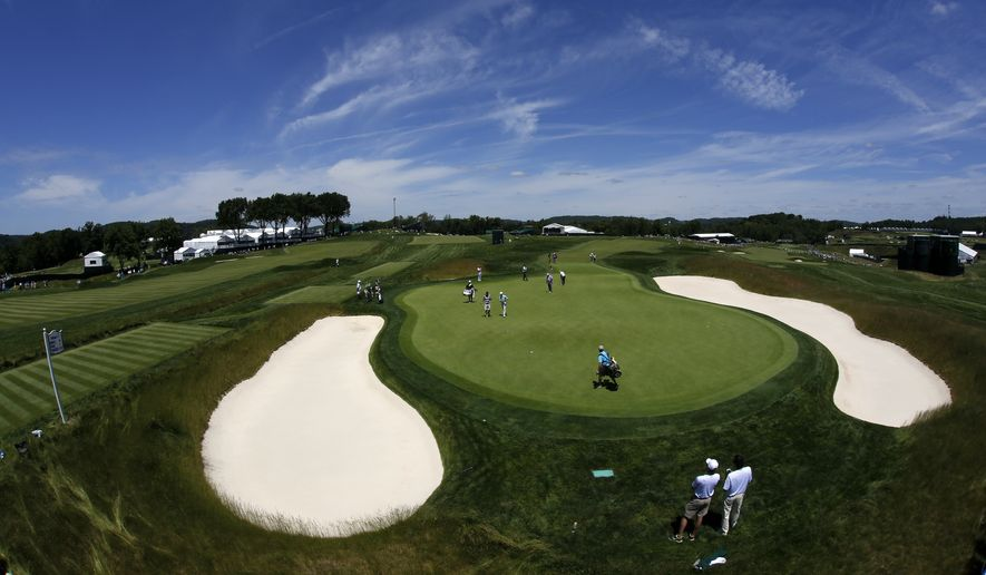 A group, including Angel Cabrera, of Argentina, who won the 2007 U.S. Open at Oakmont, practices putting on the 14th green during a practice round for the 2016 U.S. Open golf championship at Oakmont Country Club in Oakmont, Pa., Monday, June 13, 2016. (AP Photo/Gene J. Puskar)