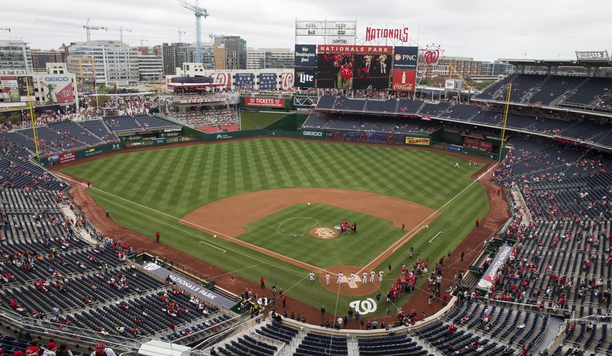 Fans await a baseball game between the Washington Nationals and the Philadelphia Phillies at Nationals Park, in Washington on Sunday, Sept. 27, 2015. (AP Photo/Jacquelyn Martin)