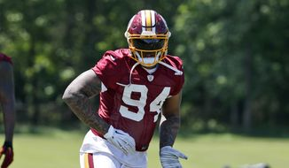 Washington Redskins linebacker Preston Smith (94) runs a drill during practice at the team's NFL football training facility at Redskins Park, Wednesday, June 8, 2016 in Ashburn, Va. (AP Photo/Alex Brandon)