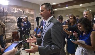Rep. David Jolly, R-Fla., answers questions from reporters, on Capitol Hill in Washington, Tuesday, June 14, 2016, after members of the House of Representatives received a closed intelligence briefing from FBI Director James Comey and Secretary of Homeland Security Jeh Johnson on the mass shooting at an LGBT club in Orlando. (AP Photo/J. Scott Applewhite)