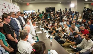Nine trauma surgeons and survivor Angel Colon speak to the media for the first time about the aftermath of the mass shooting that killed dozens and hospitalized many more at an Orlando gay nightclub, during a press conference at the Orlando Regional Medical Center in Orlando, Fla., on Tuesday, June 14, 2016.  (Loren Elliott/Tampa Bay Times via AP)