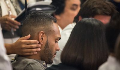 Angel Colon, a survivor of the mass shooting that killed dozens at an Orlando gay nightclub, appears at a news conference where he spoke to the media for the first time, at the Orlando Regional Medical Center in Orlando, Fla., on Tuesday, June 14, 2016. Colon's life was saved by the efforts of the trauma surgeons at Orlando Regional Medical Center, according to the hospital.   (Loren Elliott/Tampa Bay Times via AP)