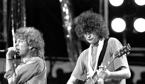 In this July 13, 1985, file photo, singer Robert Plant, left, and guitarist Jimmy Page of the British rock band Led Zeppelin perform at the Live Aid concert at Philadelphia's J.F.K. Stadium. (AP Photo/Rusty Kennedy, File)