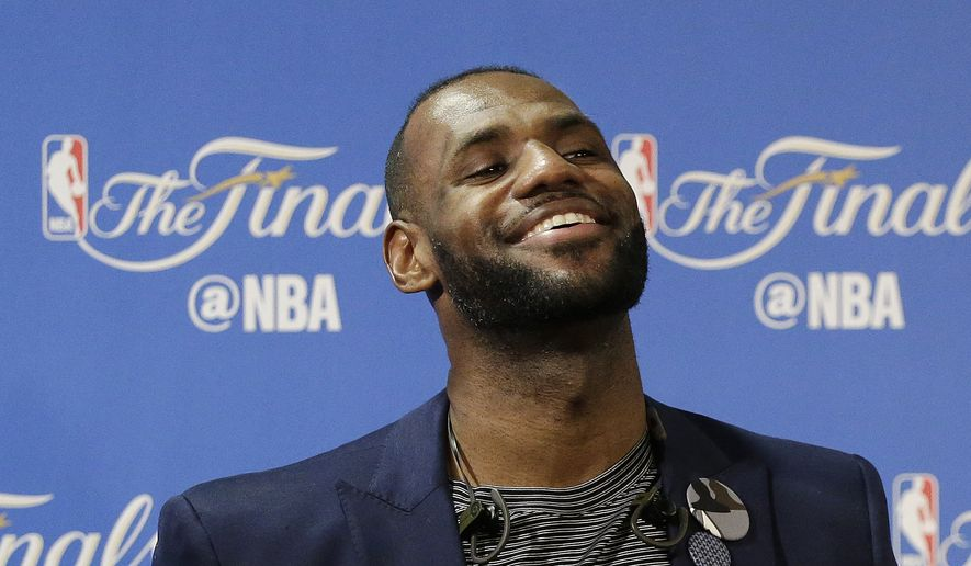 Cleveland Cavaliers forward LeBron James smiles at a news conference after Game 5 of basketball's NBA Finals between the Golden State Warriors and the Cavaliers in Oakland, Calif., Monday, June 13, 2016. The Cavaliers won 112-97. (AP Photo/Eric Risberg) **FILE**