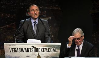 "FILE - In this Feb. 10, 2015, file photo, Gary Bettman, commissioner of the National Hockey League addresses the crowd as Bill Foley, chairman, Fidelity National Financial, Inc., Black Knight and FIS wipes his forehead during the ""Let's Bring Hockey to Las Vegas!"" press conference at the MGM Grand Ballroom in Las Vegas. A person with direct knowledge of the NHL's decision says the league has settled on Las Vegas as its choice for expansion, provided organizers can come up with a $500 million fee. The person spoke Tuesday, June 14, 2016, on condition of anonymity because details have not been released by the league ahead of its Board of Governors meeting on June 22. (AP Photo/The Sun, L.E. Baskow, File ) LAS VEGAS REVIEW-JOURNAL OUT **FILE**"