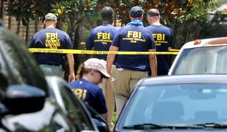 FBI agents return to the scene of the mass shooting at the Pulse nightclub in Orlando, Fla., Tuesday, June 14, 2016.   (Joe Burbank/Orlando Sentinel via AP)
