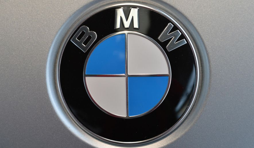 FILE - This March 19, 2014, file photo, shows the company logo of car manufacturer BMW during the annual balance news conference in Munich. BMW announced Tuesday, June 14, 2016, that the company is recalling nearly 189,000 SUVs in the U.S. because the child seat anchors may become damaged and won't hold the seat properly. The recall covers certain X3 SUVs from the 2011 to 2017 model years, as well as some X4s from 2015 through 2017. (AP Photo/Kerstin Joensson, File)