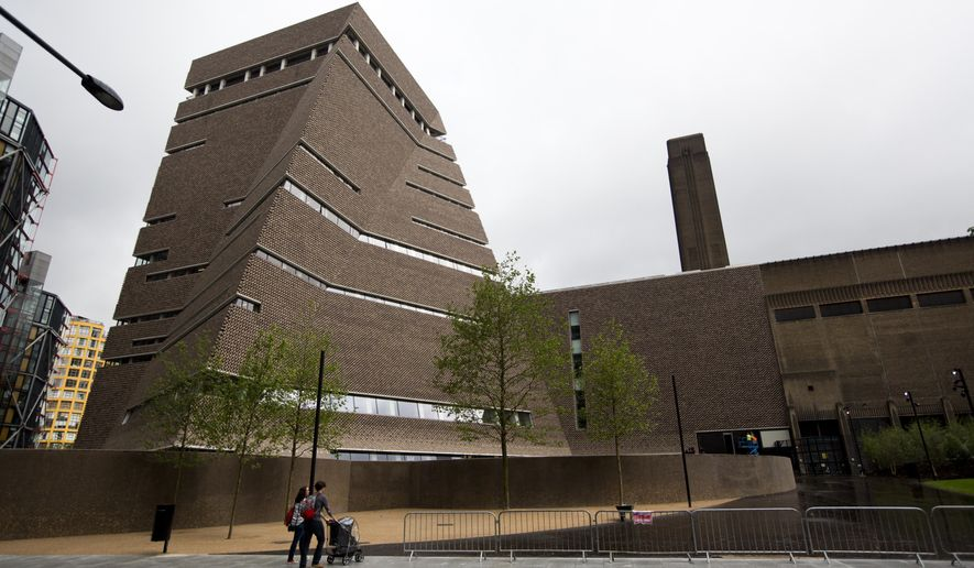 An exterior view shows a new building called the Switch House, at left, which has been added on to the Tate Modern gallery in London, Tuesday, June 14, 2016. The gallery has undergone a major refurbishment with the construction of the Switch House on the side, increasing the overall size of the space by 60%. (AP Photo/Matt Dunham)