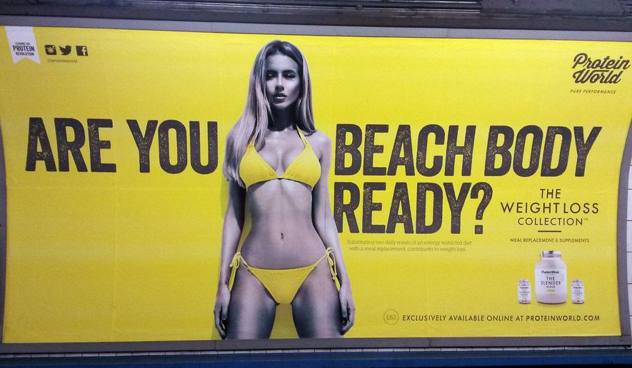 """FILE - This is an April 27, 2015 file photo  of a Protein World advert displayed in an underground station in London. London Mayor Sadiq Khan has banned advertising that promotes unhealthy body image on the city's subway network. Starting July 2016, Transport for London will not allow ads that cause pressure to conform to """"unrealistic or unhealthy body shape.""""(Catherine Wylie/Pa, File via AP)"""