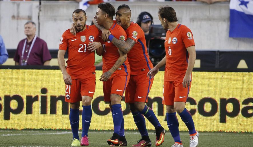 Chile's Marcelo Diaz (21), left, Eduardo Vargas (11), Arturo Vidal (8), and Jose Pedro Fuenzalida (6) celebrate Vargas' goal against Panama during the first half of a Copa America Group D soccer match, Tuesday, June 14, 2016, in Philadelphia. (AP Photo/Matt Rourke)