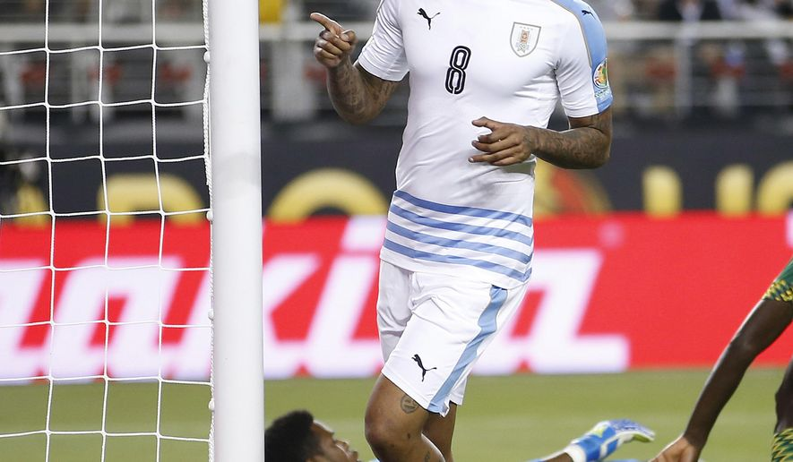 Uruguay's Abel Hernandez (8) celebrates after scoring a goal against Jamaica goalie Andre Blake, behind, during the second half of a Copa America Centenario Group C soccer match in Santa Clara, Calif., Monday, June 13, 2016. (AP Photo/Tony Avelar)