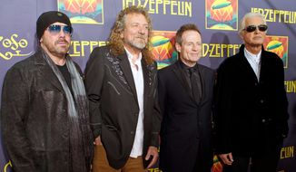 "This Oct. 9, 2012, file photo shows, from left, Jason Bonham, son of the late Led Zeppelin drummer John Bonham; singer Robert Plant; bassist John Paul Jones; and guitarist Jimmy Page at the ""Led Zeppelin: Celebration Day"" premiere in New York. (Photo by Dario Cantatore/Invision/AP, File)"