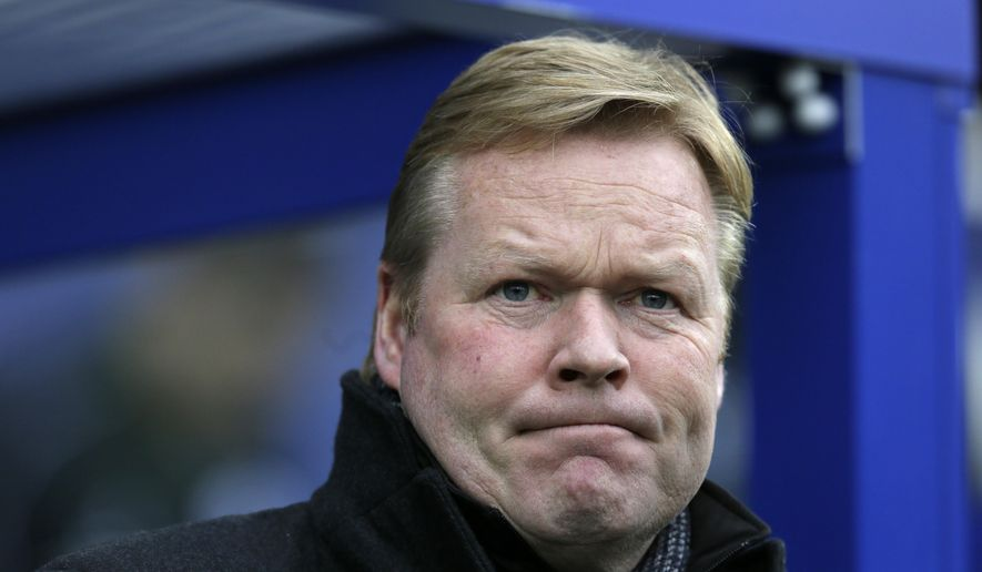 FILE - In this Saturday, Feb. 7, 2015 file photo, Southampton manager Ronald Koeman looks across the pitch ahead of the English Premier League soccer match between Queens Park Rangers and Southampton at Loftus Road, London, England. Ronald Koeman was hired to manage Everton on Tuesday June 14, 2016, after quitting English Premier League rival Southampton. (AP Photo/Tim Ireland, File)