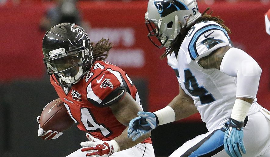 FILE - In this Sunday, Dec. 27, 2015 file photo, Atlanta Falcons running back Devonta Freeman (24) runs against Carolina Panthers outside linebacker Shaq Green-Thompson (54) during the first half of an NFL football game in Atlanta. Atlanta Falcons running back Devonta Freeman said he will take nothing for granted after earning a Pro Bowl spot in his second NFL season, Tuesday, June 14, 2016. (AP Photo/David Goldman, File)