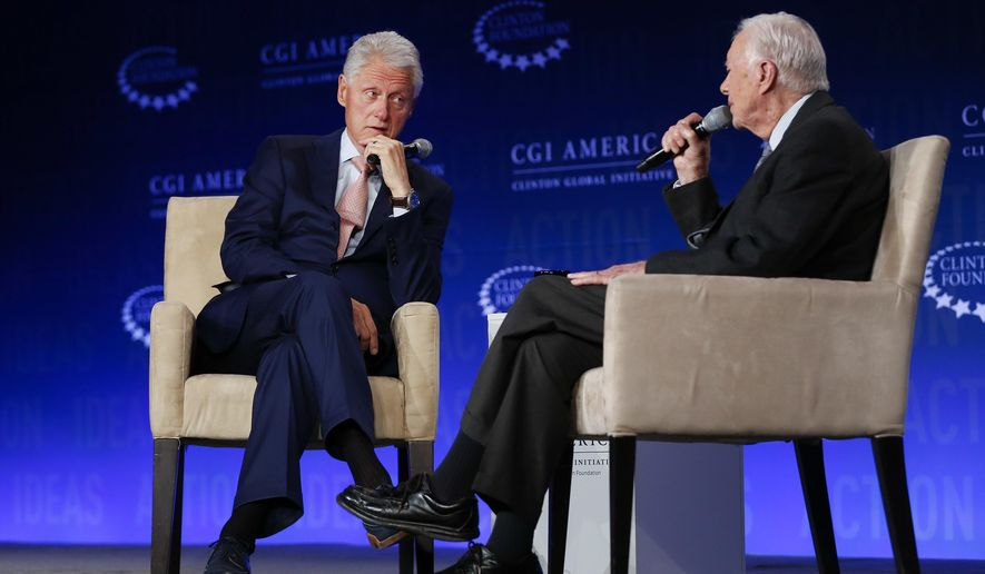 Former President Bill Clinton, left, listens to former President Jimmy Carter during a discussion at a Clinton Global Initiative meeting Tuesday, June 14, 2016, in Atlanta. (AP Photo/John Bazemore)