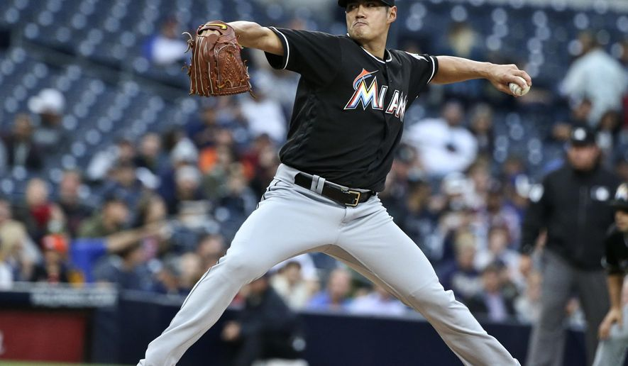 Miami Marlins starting pitcher Wei-Yin Chen throws against the San Diego Padres during the first inning of a baseball game Monday, June 13, 2016, in San Diego. (AP Photo/Lenny Ignelzi)