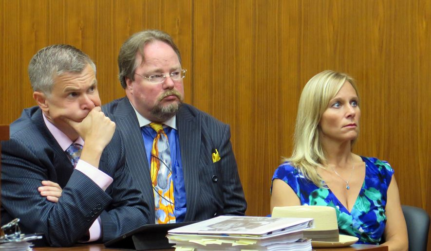 Cindy Gamrat, a former Michigan lawmaker, listens with her attorneys while Judge Hugh Clark Jr. dismisses charges against her on Tuesday, June 14, 2016, in Lansing, Mich. Gamrat, who was expelled from the state House in 2015, was facing misconduct in office charges stemming from a legislative investigation into an alleged cover-up of her extramarital affair and her staff forging her signature on proposed legislation. (AP Photo/David Eggert)