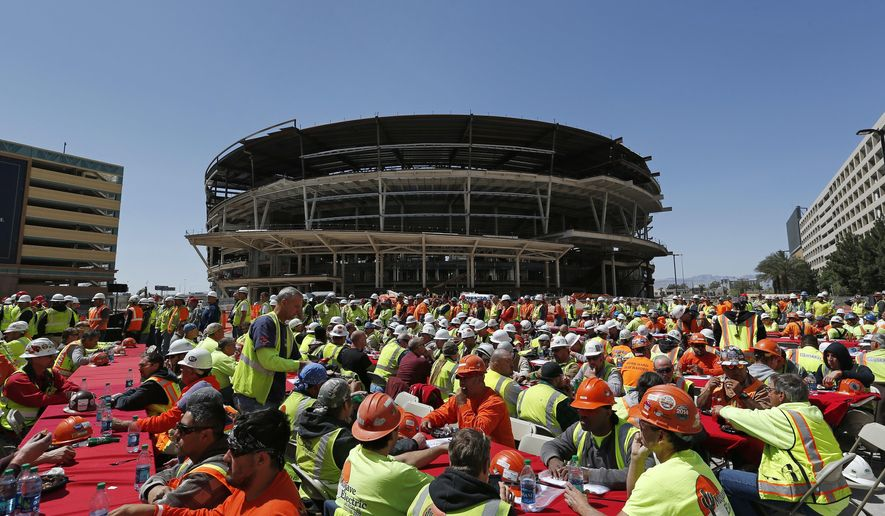 FILE - In this April 7, 2015, file photo, construction workers eat lunch by an MGM arena being built behind the New York-New York casino-hotel in Las Vegas. A person with direct knowledge of the NHL's decision says the league has settled on Las Vegas as its choice for expansion, provided organizers can come up with a $500 million fee. The person spoke Tuesday, June 14, 2016,  on condition of anonymity because details have not been released by the league ahead of its Board of Governors meeting on June 22. (AP Photo/John Locher, FIle)