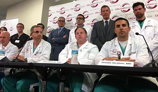 Doctors and medical staff that treated the victims of the Pulse nightclub shooting answer questions at a news conference at the Orlando Regional Medical Center, Tuesday, June 14, 2016, in Orlando, Fla. (Naseem Miller/Orlando Sentinel via AP)