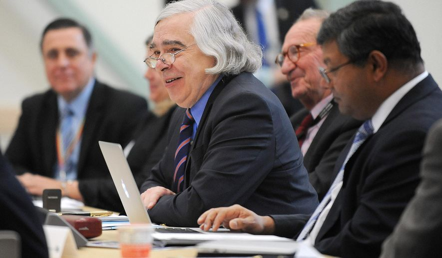 U.S. Energy Secretary Ernest Moniz addresses members of his Secretary of Energy Advisory Board at the Energy Innovations Laboratory in Idaho Falls, Idaho, Tuesday, June 14, 2016. Moniz announced that $82 million will be appropriated for nuclear energy projects in 28 states as part of the government's plan to reduce carbon emissions. (Pat Sutphin/Idaho Falls Post-Register via AP)