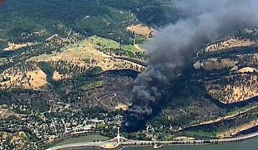 FILE--In thisJune 3, 2016, file frame from video provided by KGW-TV, smoke billows from a Union Pacific train that derailed near Mosier, Ore., in the scenic Columbia River Gorge. Oregon's Multnomah County Chairwoman Deborah Kafoury and Portland, Ore., Mayor Charlie Hales are calling on Oregon Gov. Kate Brown to oppose oil-by-rail projects like the Tesoro-Savage terminal proposed in Vancouver, Wash., and to work for a permanent ban on oil-by-rail--a request that comes in the wake of the Mosier derailment. (KGW-TV via AP, file) MANDATORY CREDIT