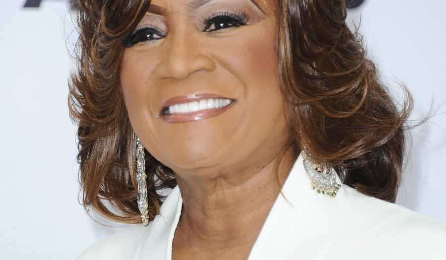 FILE - In this June 28, 2015 file photo, Patti LaBelle poses in the press room at the BET Awards in Los Angeles. LaBelle, Kenny Gamble and Leon Huff will share The Marian Anderson Award given in Philadelphia to artists who have impacted society in a positive way. The awards gala is set for Nov. 15. (Photo by Richard Shotwell/Invision/AP, File)