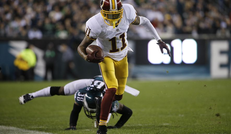 In this photo taken Dec. 26, 2015, Washington Redskins' DeSean Jackson runs after a catch in the first half of an NFL football game against the Philadelphia Eagles in Philadelphia. Jackson is keeping quiet and letting his play do the talking at Washington Redskins minicamp. After skipping all but two voluntary workouts, the wide receiver made an impression with some big catches during the first day of mandatory minicamp Tuesday, June 14, 2016. (AP Photo/Matt Rourke)