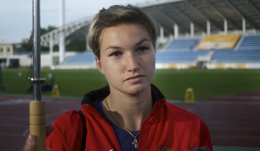 In this photo taken Saturday, June 4, 2016, Russia's javelin thrower Vera Rebrik speaks to the media after competing at the Znamensky Brothers Memorial athletics meet in Zhukovsky just outside Moscow, Russia. Former European champion javelin thrower Vera Rebrik is trying to rebuild a career thrown into turmoil by her decision in 2014 to switch from Ukraine to Russia. Two years on from Russia's annexation of Crimea, athletes from the Black Sea peninsula are split between Russia and Ukraine and could win medals for both countries at August's Olympics in Rio. (AP Photo/Ivan Sekretarev)