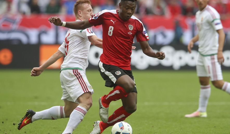 Austria's David Alaba, right, dribbles past Hungary's Laszlo Kleinheisler during the Euro 2016 Group F soccer match between Austria and Hungary at the Nouveau Stade in Bordeaux, France, Tuesday, June 14, 2016. (AP Photo/Petr David Josek)