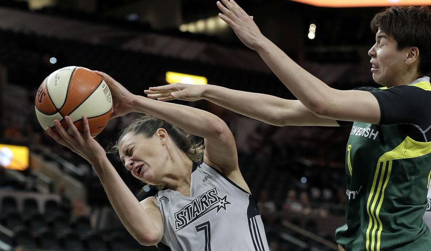 San Antonio Stars forward Haley Peters (7) is fouled by Seattle Storm forward Ramu Tokashiki, right, during the first half of a WNBA basketball game, Tuesday, June 14, 2016, in San Antonio. (AP Photo/Eric Gay)