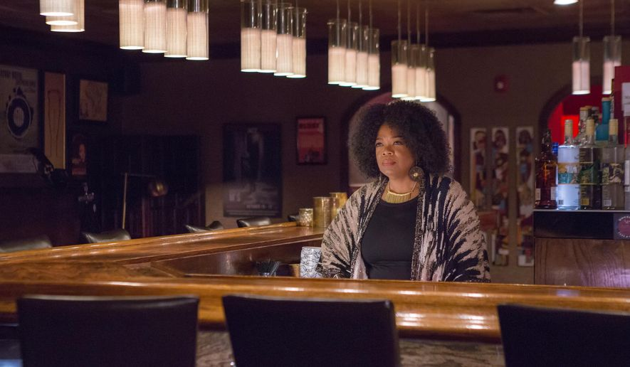 "This image released by OWN shows Oprah Winfrey as Mavis McCready in a scene from the original series, ""Greenleaf."" The show, which premieres Tuesday at 10 p.m.,  explores the flawed nature of the first family of a sprawling Memphis, Tennessee, megachurch.  Winfrey, who is the executive producer, plays an outspoken bar owner she calls the ""high priestess"" of the neighborhood. (OWN via AP)"