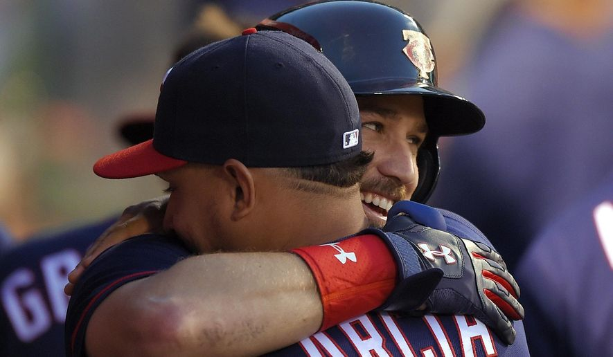 Minnesota Twins' Trevor Plouffe, right, is congratulated by Oswaldo Arcia after hitting a three-run home run during the third inning of a baseball game against the Los Angeles Angels, Monday, June 13, 2016, in Anaheim, Calif. (AP Photo/Mark J. Terrill)